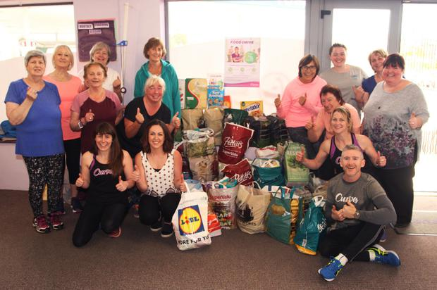 At front: Curves proprietor, Roisin Hearns; Mandi Tighe of Gorey Youth Needs; Yvonne Kinsella, Curves manager; Fionn McDonald; and supporters and friends