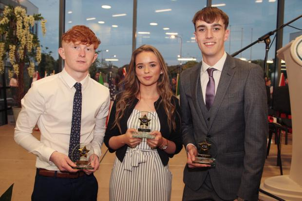 At the sixth year awards: Footballer of the Year Eoghan Haugh,Ladies'Footballer of the Year Teighlour Fegan and Hurler of the Year Ross Cody