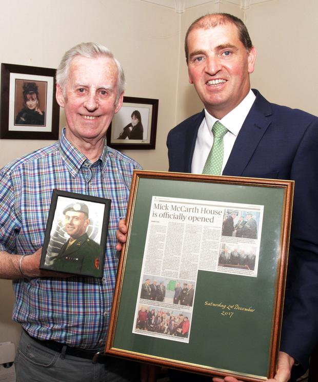 Brendan McCarth, brother of the late Mick McCarth with Minister of State with responsibility for Defence Paul Kehoe at the opening of Mick McCarth House