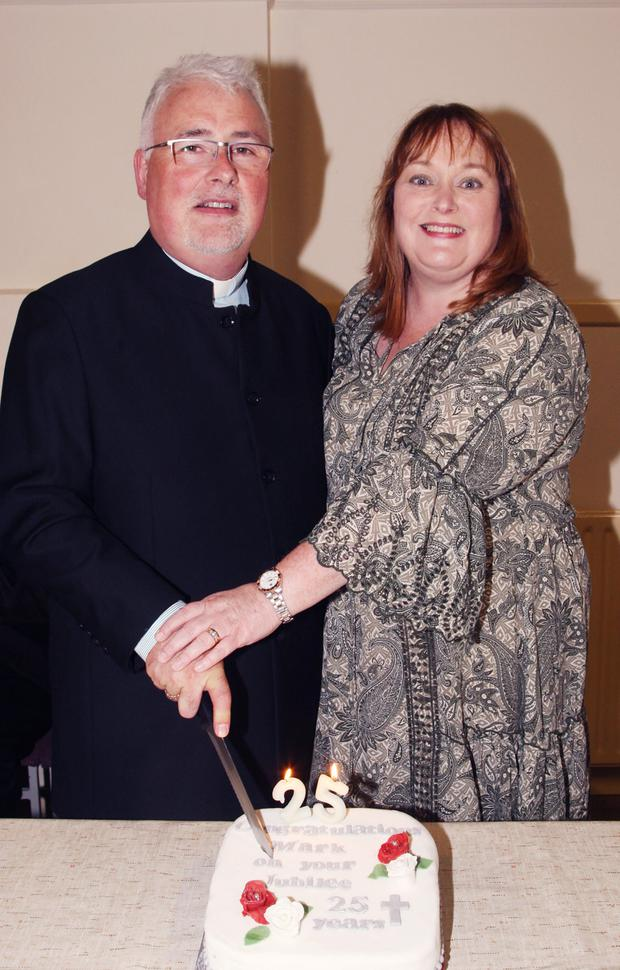 Canon Mark Hayden and his wife Lorraine cutting the cake at his Silver Jubilee celebrations