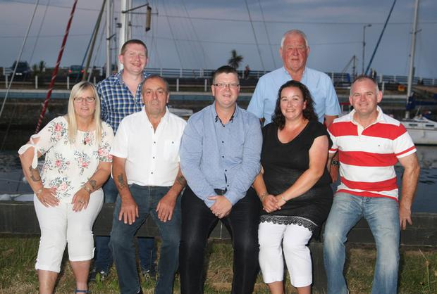 Pictured in Courtown Harbour honouring Irish Coast Guard members retiring were: Front, from left, Geraldine Sinnott, Eddie Byrne (retired) David Swinburne OIC, Sharon Redmond (retired) and David Kavanagh; Back, Peter Donegan DOIC and Jim Murphy former OIC