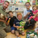At the launch of teddy bears clinic at Whelan's Pharmacy were Michael Gleeson with his son, Mika, and Pharmacist, Ed Whelan with his children, James, Clara and Anna