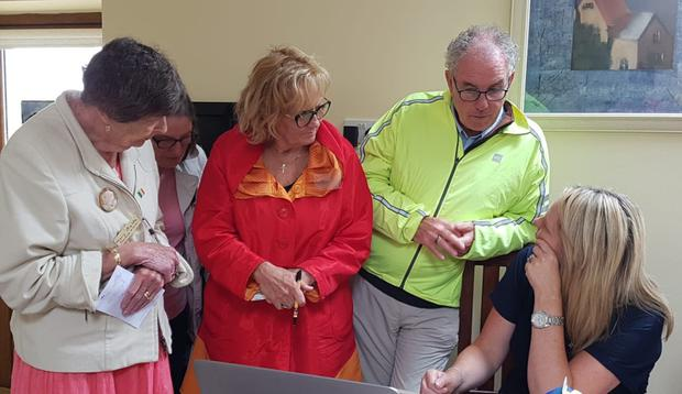 Canadians Mary Campeau, Anne Kraushaar and John Balfe getting genealogical help from Catherin Wright