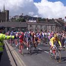 Chris Boardman, in the yellow jersey, leads the pack as the riders leave Enniscorthy at the start of the 205km second stage to Cork