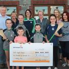 At the presentation of €1,672 to the North Wexford Hospice from the Patrick Sheil Memorial Tournament: Front: Kate Flynn, Jack Kenny, Saidhbhe Sheil, Kaitlyn Kenny and Zoe Lawlor. Back: Dr Michael and Margeret O'Doherty, Stephanie Flynn, Rosemary Melbourne, Megan Cullen and Noeleen Furlong