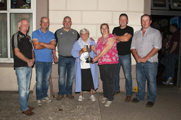 Mosies Boys, the Division 1 winners, receive their cup (from left): Leo Gleeson, brothers, Brian and Mosie Kenny with their mother, Molly Kenny, organiser, Margaret Boland, Foxy Kavanagh and Larry Kavanagh