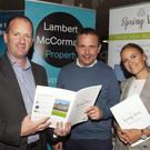 Auctioneer Victor Lambert with Stephen and Kate Mahon from Trinity Homes