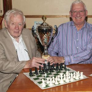 Gorey Chess Club prizewinners in the Loch Garman Arms. Tadhg Kelly presents the Cathal Kelly Memorial Cup to the overall winner, John Lacy, Syd Cassidy 2nd place, chairman Seamus Halpenny joint 3rd. Missing from picture, Manual Gardenes joint 3rd winner