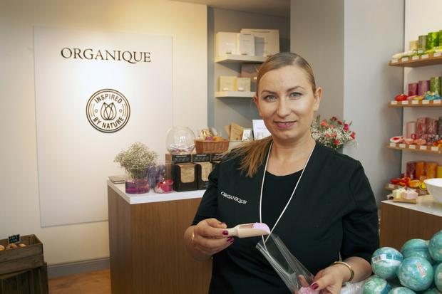 Anna Baprawska packing guava bath power at her newly opened shop, Organique, in Gorey