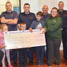 Members of the gardai and the fire service present a cheque for€24,116 to St Patrick's Special School after the very successful Blue Light Fight Night