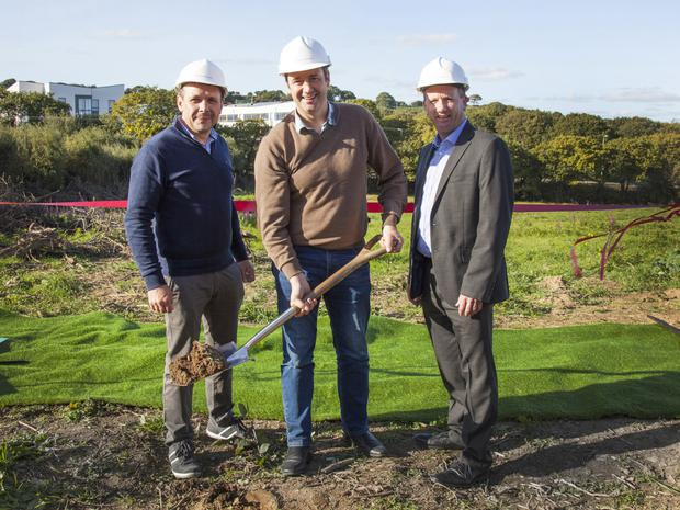 Minister Michael D'Arcy turning the sod with Stephen Mahon (left) from Trinity Homes and Victor Lambert from Lambert and McCormack Properties