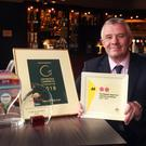 Amber Springs Hotel general manager Eibhear Coyle with the four awards they have won this year