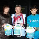 Amanda, Kathleen and Sean Traynor collecting for LauraLynn as the trucks passed by
