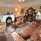 The sitting room at the lodge, with many of the lots in situ