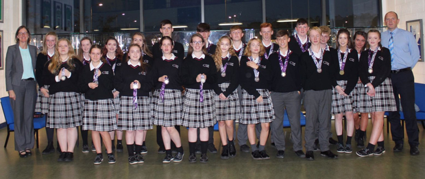 Creagh College students from the Junior Certificate class who received Grade A in Higher Level subjects with their acting deputy principal, Janet Wallace, and acting principal, Declan O'Toole