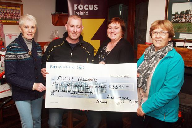 Bridget Keogh, Jason Keogh, Cathryn O'Leary of Focus Ireland and Stacy Gilbert at the presentation