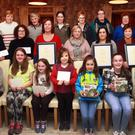 Ferns Tidy Towns annual presentation at the Courtyeard. Front: Scoil Naomh Maodhog green schools winners, Bethany Reddin, Andrea Mulhall, Aoibheann Mulhall, Lucy Breen, Mia Murphy, Leah Murphy and Leah Connor. Middle row: Kathleen Dunbar-Reddin collecting her brother's, Fran Dunbar,Coolbawn best residential garden award; Phil Murphy, McMurrough Court, best residential area award; Ann Doyle (Doyle's bar), best public house; chairperson, Mary Gethings; proprietor, Carol Walsh the Unique Escape best shopfront award and Margaret Plummer best commerical shop front award. Back row: committee, Bernie Doyle, Angela Breen, Melissa Kehoe, Kathleen Denby, Angela Redmond Mulhall, Teresa Bailey and Rose McElwain