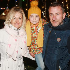 Shay Hammel, who sponsored the Christmas tree, with his wife Kara and children Robbie and Darcie