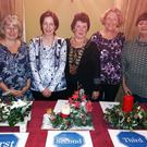 The winners of the Christmas table competition at the ICA Federation meeting: Marie Porritt (Oulart) - 1st; Theresa Donnelly (Gorey) - 2nd; Mary D'Arcy, Federation president; Betty Crean (Bree) - 3rd; and Catherine Dunleavy, competitions secretary