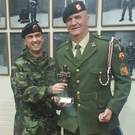 Company Quartermaster Sergeant Matt Colfer is presented with a special statuette from Lieutenant Aidan Douglas