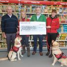 John Considine, chairman of Autism Assistance Dogs Ireland, Nuala Geraghty, CEO of Autism Assistance Dogs Ireland, Ciaran O'Neill, Managing Director of Maxi Zoo Ireland and Eadaoin O'Gorman from Autism Assistance Dogs Ireland along with Jamie and Koda