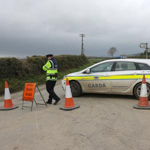 A garda car blocks the road to where skeletal remains were found near Ferns
