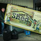 Donnacha Murphy and Bob McCausland carrying away the sign for Gorey's Men's Shed