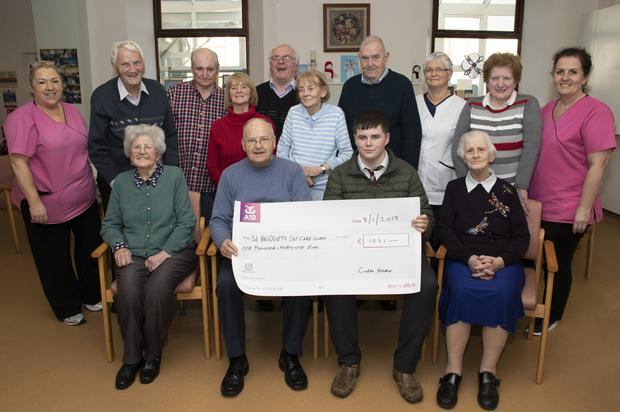 Ciarán Hearne presents the cheque for €1,031 to St Bridget's Day Care Centre