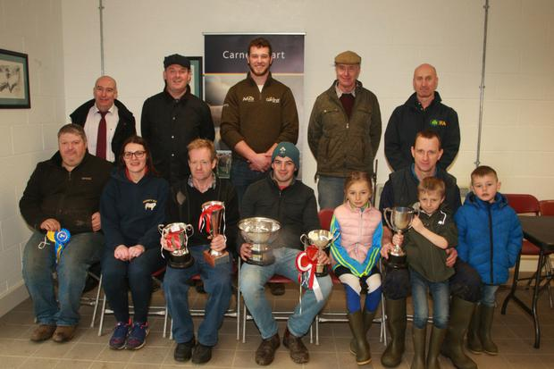 Front row: Prize winners Willie Devereux, Dawn Kinsella, Quinns Mart; Patrick Greene, Melvin Masterson, champion bullock; Brian Doyle with his daughter Clodagh and son Ciaran Doyle and Jack Horan. Back row: Alan McBride, AIB; Alan Mooney, Ensor O'Connor Solicitors; Stephen Gardiner, Gardiner Grain; prize winner Derry Rothwell and Angus Woods, IFA