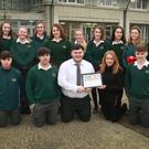 Student Jack Ryan on behalf of Gorey Community School's 6th year Geography class accepts the Dublin Institute for Advanced Studies certificate from class teacher Catherine O'Brien
