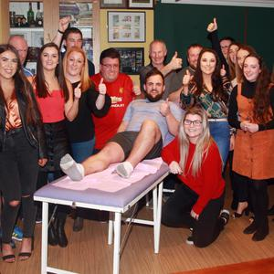 Organisers and participants of the Naomh Eanna Ladies football fundraiser at the Complex Bar, including Tommy Martin, who had his legs waxed on the night