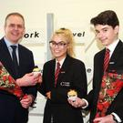Minister for Education and Skills Joe McHugh visits Creagh College on Valentine's Day receiving flowers and cakes from students Casey Kintsch Nolan and Brandon Paisley