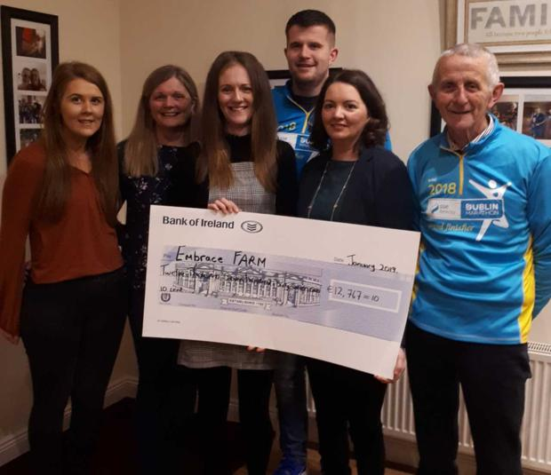Siobhan Merrigan, Penny Tracey, Kerrie Kehoe, Kieran Tracey, Norma Rohan, and Bob Tracey at the presentation of the cheque to Embrace FARM
