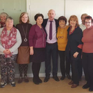 The members of Tomhaggard Women's Shed with Cllr. Frank Staples who donated sewing machines and a laptop to the project