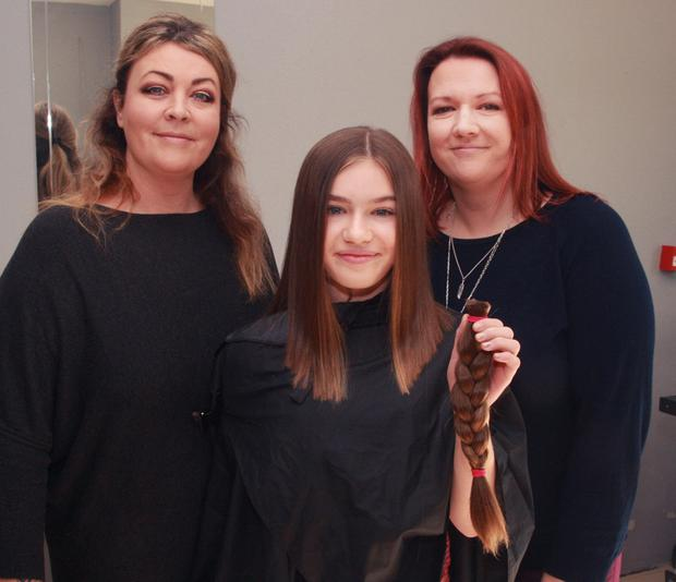 Faye Jordan, Bunclody, who had her hair cut and donated to the 'Little Princess Trust' for young adults and children who need good quality wigs, pictured with her auntie and proprietor, Tara Baker (left) and her mother Lyndsey Jordan