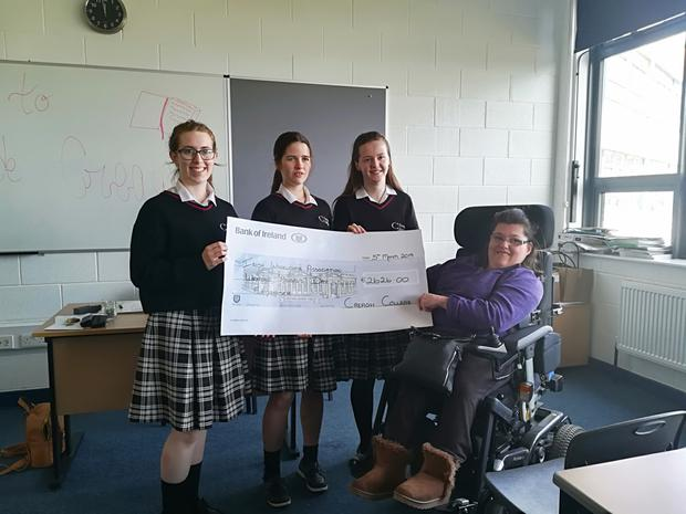 Three students from TY in Creagh College present a cheque to €2,626 to Sarah Louise Fortune of the IWA
