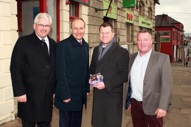 Fiann Fáil leader Micheál Martin (second from left) on the campaign trail with Cllr Joe Sullivan, Cllr Malcolm Byrne and Donal Kenny