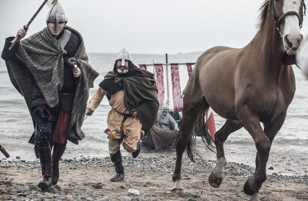 Norman soldiers storm Bannow Beach in a reenactment of the invasion of 1169