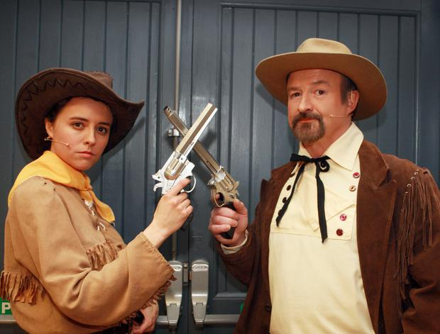 Lindsey Tindall as Calamity Jane and John Young as Wild Bill Hickock