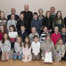 Bishop Denis Brennan presented certificates for Creative Spirit Awards winners at Clonard Community Centre