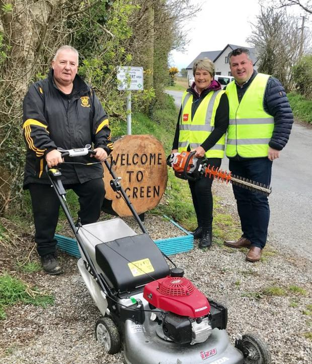 Mower power to them: Tony and Theresa Kehoe, with Cllr George Lawlor