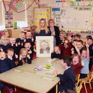 Texaco art competition overall winner Naoise Hennessy at her former primary school Ballyellis NS, with her mother Marie Hennessy and Junior and Senior infants