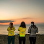 Participants of Courtown's Darkness Into Light take a moment to capture the sunrise following Saturday's walk, where over 1,000 people took part. Photo courtesy of Glen Deacon