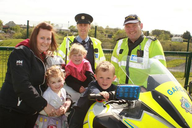 Sgt Kevin Bolger and Garda Mick Dee with Casey Lawlor and her children Molly, Abigail and Robert Ireton
