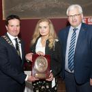 Overall winner of the Texaco Art competition, Naoise Hennessy, accepting her award from Cllr John Hegarty, cathoirleach Gorey Municipal District and Cllr Joe Sullivan