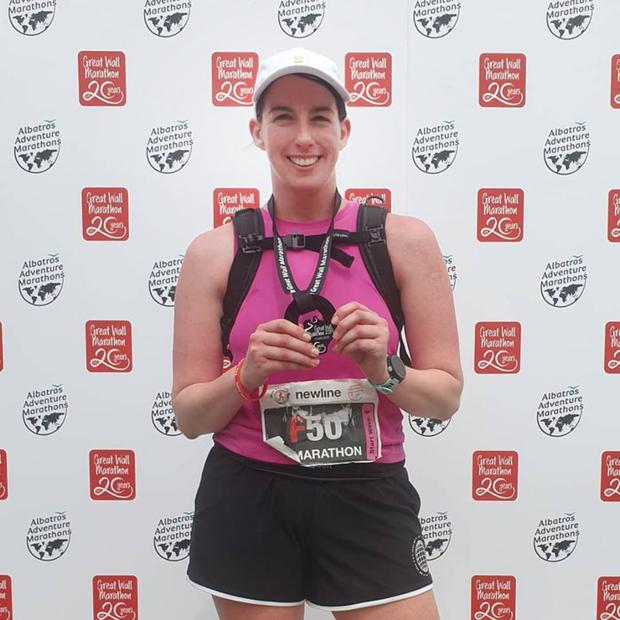 Done and dusted! Donna Murphy at the finish line with her medal for The Great Wall Marathon