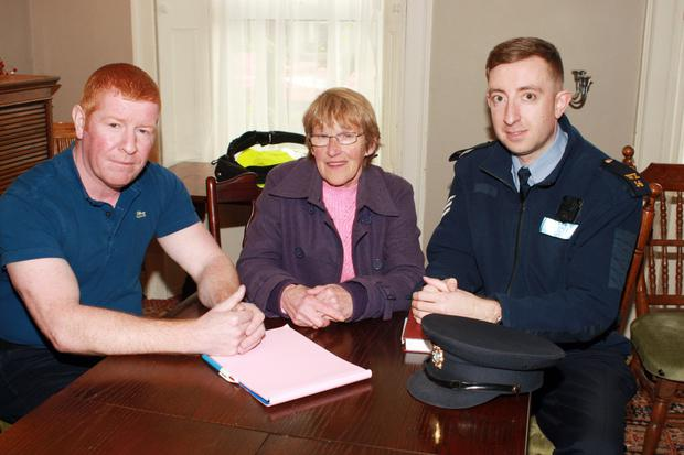 Jimmy Fleming, who chaired the meeting, with Catherine O'Neill and Sgt Tom Barrett