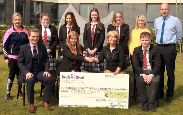Creagh College students presented a cheque of €3,733 to Temple St Children's Hospital following their recent sponsored walk. Front row: principal Paul Glynn, Amy Lynch, Ger Donnelly, Temple Street Foundation and Stephen Barry. Back row: Nuala Kavanagh, Aoife O'Neill, Roisin Stafford, Ciara Kennedy, Isobel Cummins, Edel Peters and deputy principal Declan O'Toole