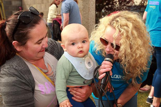 Ciara Dixon with her son Oliver and singer Jessie Daly from the band Elysium