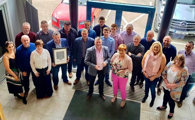 Family members, staff and management at K&K Windows in Craanford with their award for being the All-Star Family Business of the year